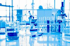 Glassware equipment in laboratory for science or chemical experiments, medical and pharmaceutical research concept royalty free stock images