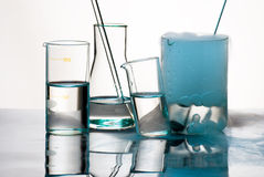 Glassware during experiment with blue vapors Stock Photo
