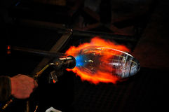 Glassware making. A glassware is being shaped by using a torch Stock Photos