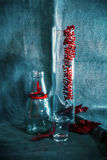 Glassware And Necklace On Sackcloth Royalty Free Stock Image