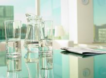 Glassware and newspaper Royalty Free Stock Photography