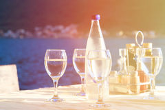 Glassware served in outdoor restaurant on resort Stock Images