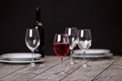 Glassware on wooden table Stock Photo