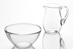 Glasswares. Empty glass jug and bowl Stock Images