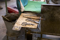 Glassworks tools closeup view using for glass manufacturing process Stock Photos