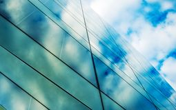Glassy Architecture. Modern Commercial Building Glass Wall and the Sky royalty free stock image