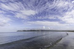 Mahia Beach Morning. Glassy calm conditions in the morning at Mahia Beach, which is a popular vacation spot at the northern end of Hawkes Bay NZL royalty free stock photos