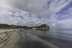 Mahia Beach Morning. Glassy calm conditions in the morning at Mahia Beach, which is a popular vacation spot at the northern end of Hawkes Bay NZL stock image