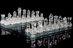 Glassy chessboard on black Stock Photo