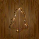 Glassy Christmas tree on wooden background Stock Images