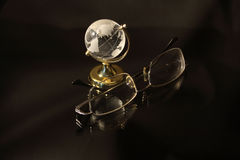 Glassy globe and spectacles Royalty Free Stock Photography