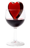 Glassy heart in a glass of wine Stock Photos