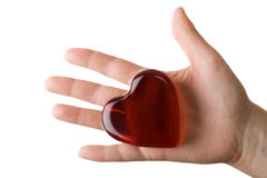 Glassy heart on the woman's palm 2. Glassy heart on the woman's palm isolated Royalty Free Stock Photo