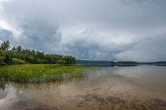 Glassy Lake. Shot from the beach at a glassy lake in Sweden royalty free stock photo