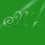 Glassy Letters in Italics. Shine Transparent Glass Italic Letters M on the Green Background Royalty Free Stock Photography