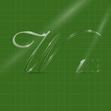 Glassy Letters in Italics. Shine Transparent Glass Italic Letters W on the Green Background Stock Photography