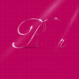 Glassy Letters Writing in Italics. Shine Transparent Glass Italic Letters Ron the Pink Background Royalty Free Stock Photos