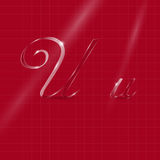 Glassy Letters Writing in Italics. Shine Transparent Glass Italic Letters U on the Dark Red Background Royalty Free Stock Photo