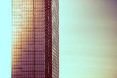 Glassy Modern Building. At Sunset. Warm Vintage Color Grading. Architecture Concept royalty free stock photography