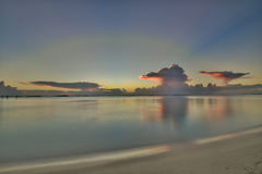 Glassy ocean sunset in the Bahamas. Beautiful Bahamian sunset reflection upon a glassy ocean surface royalty free stock photo