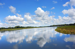 Glassy Reflection of Sky. View from the Yahara River Trail, gives glassy reflection of sky and clouds in the peaceful water of the River royalty free stock photos