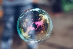 Shiny Droplet Bubble. Glassy Sparkling Shiny Droplet Bubble On Blurred Background royalty free stock photo