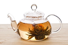 Glassy teapot with Lotus Flower Chinese tea. On white background royalty free stock photo