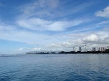 Glassy water of Ala Moana Beach with Condo buildings and constru Stock Photography