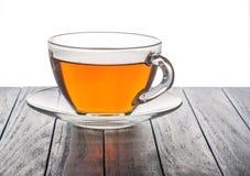 Glastasse tee auf einem hölzernen Hintergrund Stockfotos