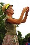 Glastonbury Festival older woman in daisy hat. Glastonbury, United Kingdom - June 29, 2014: Glastonbury Festival, England's most famous summer music festival Stock Photo