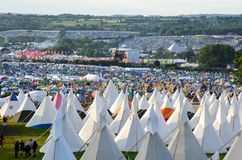 Glastonbury Festival, UK. 06/27/2015. Looking across Glastonbury Festival on a sunny day. With the teepee field in the foreground. Glastonbury Festival, UK. 06/ royalty free stock images