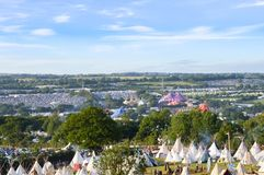 Glastonbury Festival, UK. 27/06/2015. Looking across Glastonbury Festival on a sunny afternoon, With the teepee field in the foreg. Round royalty free stock image