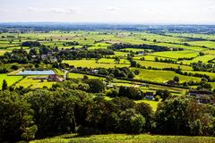 Glastonbury fields. And planes in vivid green as seen from the Glastonbury Tor , Wales, England Royalty Free Stock Photography