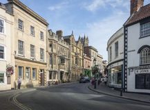 Glastonbury High Street. SEPTEMBER 28 2014, GLASTONBURY, SOMERSET, UK - View looking up the High Street from the Market Place Royalty Free Stock Image