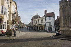 Glastonbury Market Place and High Street. SEPTEMBER 28 2014, GLASTONBURY, SOMERSET, UK - View looking up the High Street from the Market Place Royalty Free Stock Photography