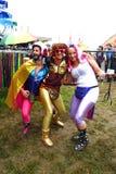 Glastonbury music festival fun fancy dress costumes. Glastonbury, United Kingdom - June 26, 2014: At Glastonbury Festival, outrageous outfits help these festival Royalty Free Stock Image
