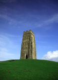 Glastonbury Tor against a vivi. D blue sky and green grass Stock Photo