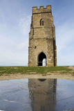Glastonbury tor church ruins somerset. Ruins of St. Michael's Tower at the top of glastonbury tor in somerset england, reflected in directional compass Stock Photography