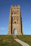 Glastonbury Tor Church Tower. The church tower on top of Glastonbury Tor in Somerset, England lit by evening sun against a blue sky stock photography