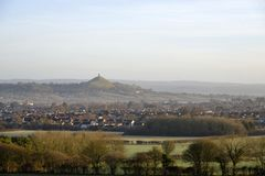Glastonbury Tor. With Street & Glastonbury, viewed from Polden Hills, Somerset Stock Image
