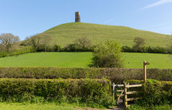 Glastonbury Tor hill Somerset England. Glastonbury Tor, Somerset, England, which features the roofless St. Michael's Tower. It is a Scheduled Ancient Monument at Royalty Free Stock Images