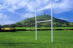 Glastonbury Tor, A sacred site along the English countryside in Glastonbury, England and goal posts in green field Royalty Free Stock Photography