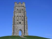 Glastonbury tor, somerset. Glastonbury tor in somerset england against a brilliant blue sky Stock Photos