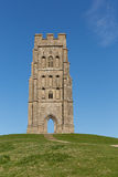 Glastonbury Tor. Somerset, England, which features the roofless St. Michael's Tower. It is a Scheduled Ancient Monument at the location believed by some to be Stock Photography