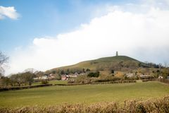 Glasonbury Tor with the ruins of St Michael`s Church. Glastonbury Tor in Somerset, United Kingdom, with the ruins of St Michael`s Church demolished in 1539 Stock Photography