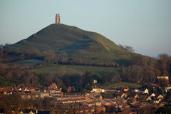 Glastonbury Tor and Town. Glastonbury tor and the town of Glastonbury, Somerset, England, UK Royalty Free Stock Photos