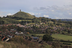 Glastonbury. Tor and the town on the Somerset levels area of Somerset, England, UK on a sunny day Royalty Free Stock Images