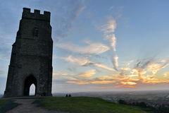 Glastonbury Tor. Glastonbury, UK - August 30, 2014: View of Glastonbury Tor against a beautiful sky at sunset. The Tor is a popular travel destination and cited Royalty Free Stock Photography