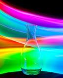 Glasvase mit Funken und Lichtwellen Stockbild