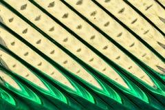 Glasvenster met stroken in een tint van groen en geel, abstracte het glastextuur van het strookformaat als achtergrond royalty-vrije stock foto's